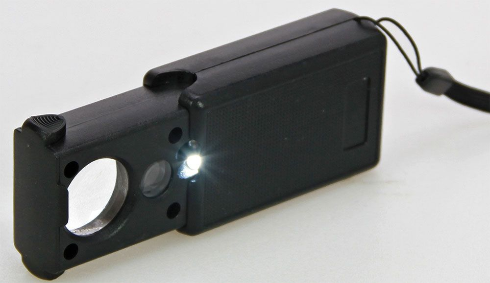 Safe - Multifunctional sliding magnifier with 30- and 60x magnification